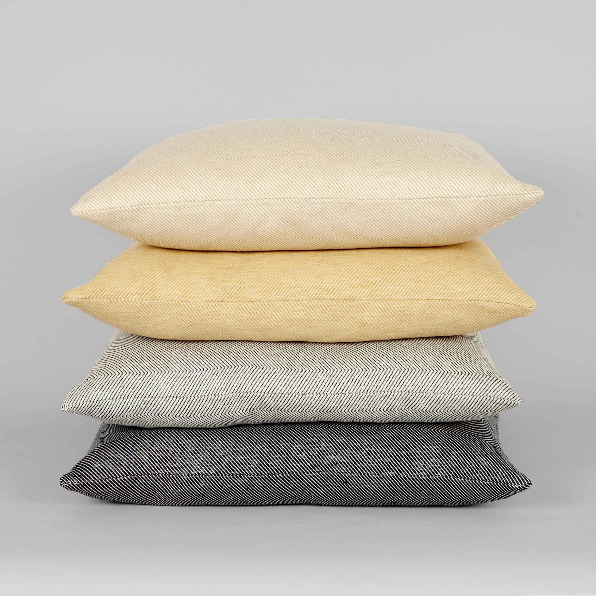 Square cushions in linen/cotton herringbone weave, design by Anne Rosenberg, RosenbergCph