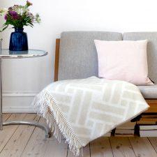 light coral linen/cotton cushion, green weave throw