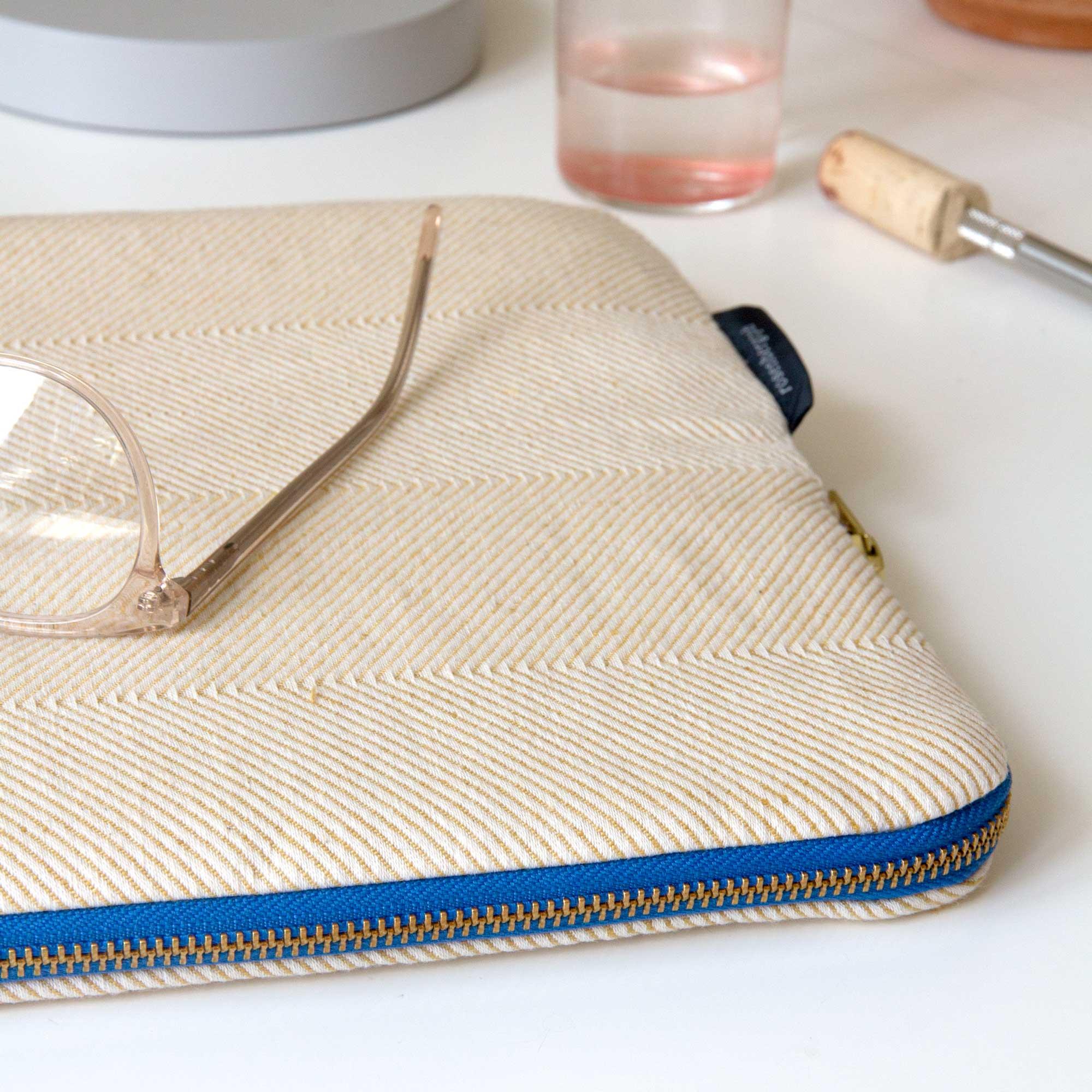 Escape laptop sleeve in light hay yellow herringbone weave, design by Anne Rosenberg, RosenbergCph